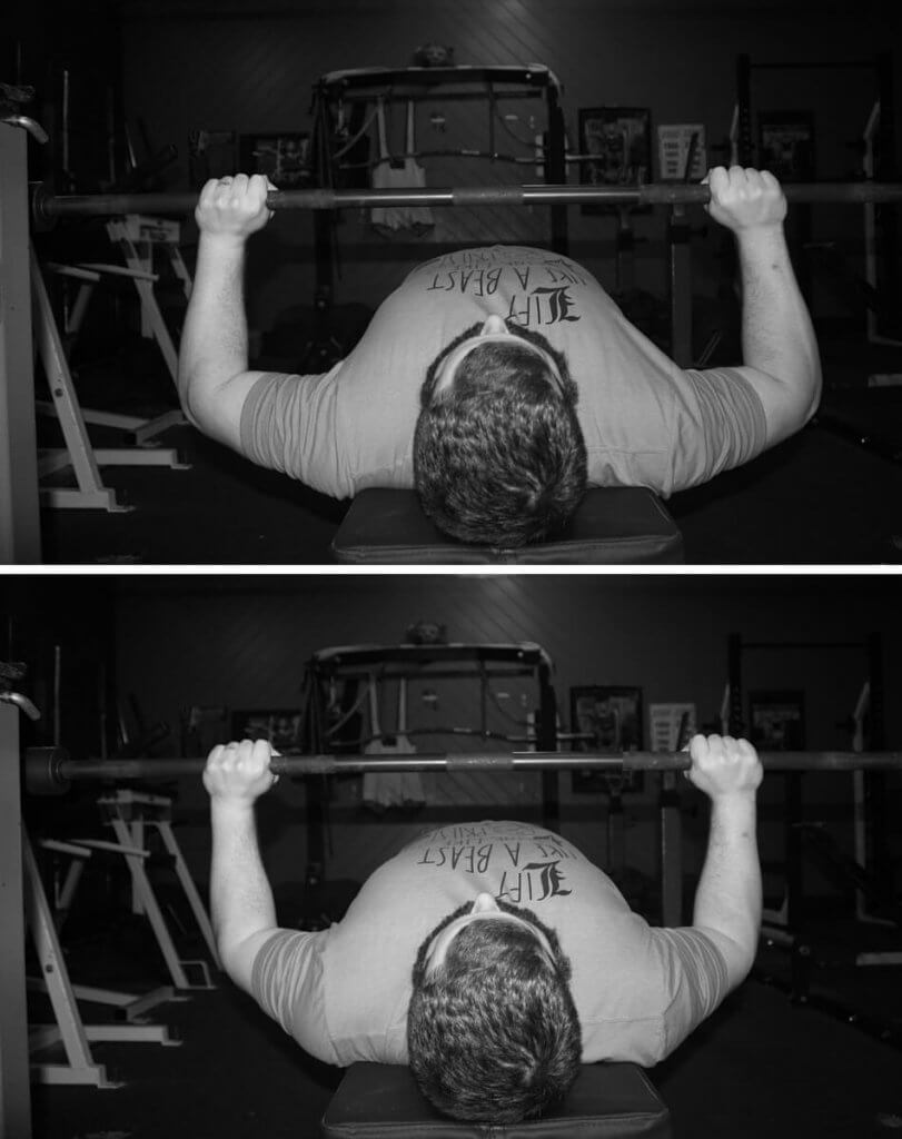 More tucked while elbows are still under the bar (bottom) = lower demands on the triceps